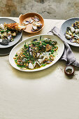 Clams with peas and pancetta