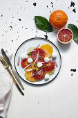 Citrus salad with mozzarella and red onions
