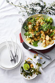 Indian spiced potato salad with curry leaves, coriander and mint
