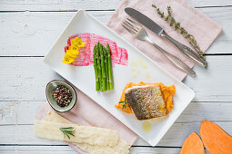 Roasted salmon trout with sweet potato puree and green Thai asparagus