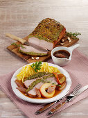 Roast veal under the herb crust with cider apples