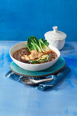 Japanese ramen with chicken and pak choi