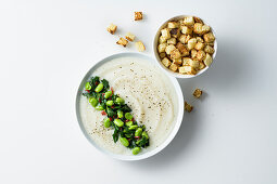 Cream of potato soup with broad beans and Catalogna chicory