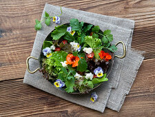 Mixed lettuce with edible flowers and feta