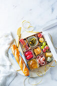 Spicy and sweet snacks for Christmas, decoratively arranged in a box