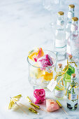 Decorative flower ice cubes and flavored gin for gifting