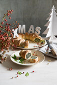 Wreath of bread filled with Swiss chard, ricotta and ham for Christmas