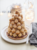 Croquembouche with whipped cream and roasted almonds