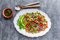 Quinoa salad with chickpeas, avocado, cucumber and tomatoes