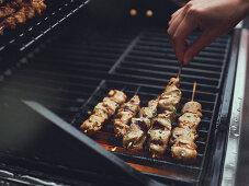 Sate skewers on a grill rack