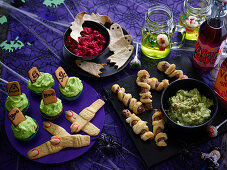 Halloween buffet with Mummy sausages with ghostly guacamole