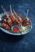 Chicken skewers with sesam and soy