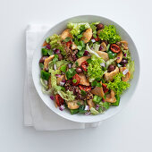 A colourful salad with roast chicken breast