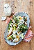 Cos lettuce with roasted corn, chicken, feta cheese and chilli
