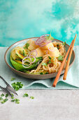 Oriental noodles with crispy fish and bok choy