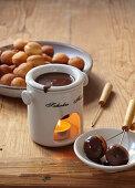 Chocolate fondue with small doughnuts