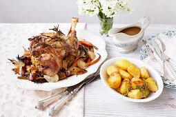 Stuffed leg of lamb with fondant potatoes