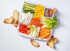 A platter of raw vegetables with an anchovy and garlic dip and grilled bread