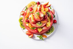 Watermelon tower with kiwi, cherries, apricots, strawberries and peaches