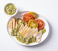 Chicken breast with salsa verde and tomatoes