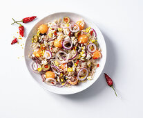 Rice salad with olives, eggs, anchovies, sheep's cheese and melon
