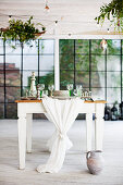 Festively set country-house table in industrial building