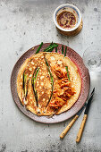 Korean pancakes with kimchi, spring onions and soy sauce