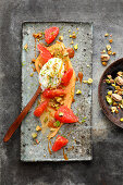 Grapefruit with lime yoghurt and pistachio nuts on toffee cream