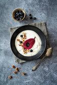 Red wine pear with honey yogurt, granola and blueberries