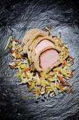 Gammon in a pomace crust with Bavarian cabbage