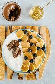 Mini pancakes with natural yoghurt, blueberry and chocolat cream