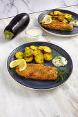 Eggplant schnitzel with fried potatoes and mayonnaise