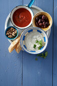 Tomato dip, mint yogurt, olives and pistachios