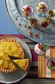 Almond semolina cake, pomegranate mousse with pistachio crunch