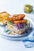 Po' boy ciabatta sandwiches with fried hake fillets