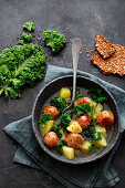 Potato and kale stew with dumplings