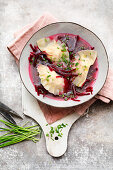 Beetroot bouillon with walnut wontons