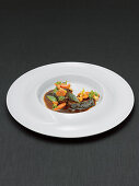 Veal cheeks with baby vegetables