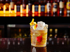 An Old Fashioned cocktail in a bar