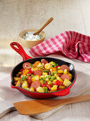Potato hash with peppers and pepper salami