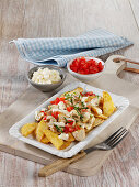 Canadian poutine with mozzarella, mushrooms and tomatoes
