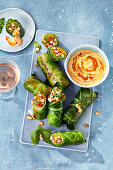 Stuffed cabbage rolls with a coconut and peanut dip