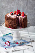 A layered cake with berry and mascarpone cream