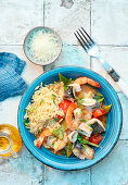Greek seafood platter with orzo in tomato stock
