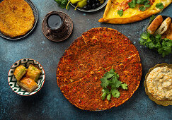 Lacmacun - traditional Turkish pizza made of dough with minced meat, vegetables and herbs topping