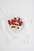 Fruit skewers with mini marshmallows and popcorn