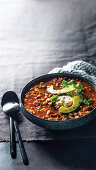 Mexican beef soup with avocado