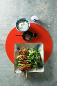 Japanese yakitori skewers with sesame spinach