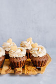 Chocolate peanut butter cupcakes decorated with heart shaped mini cookies