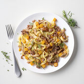Tagliatelle with porcini mushroom and pumpkin sauce, and sausage